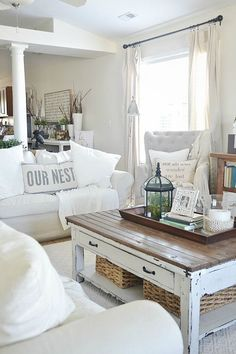 "Lovely neutral living room - Cozy ikea slipcovered couches, rustic touches, antiques. I would do a little less white though. I'm really pinning this for the ""Our nest"" pillow"