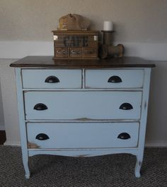 Pale blue, distressed antique dresser with wood top