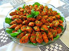 Mercimekli Köfte Red Lentil Köfte  Ingredients:  2 c red lentils 1 c fine bugur 4 c water 1 large onion, finely chopped 2 t salt 2 t red flake pepper 2 t cumin 1 t black pepper 1 T pepper paste 5-6 scallions, chopped ½ bunch parsley, chopped ¼ c olive oil