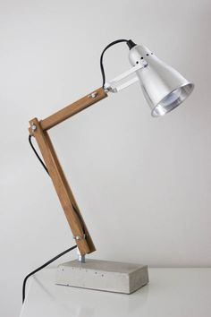 DIY industrial style wooden desk lamp with concrete base.