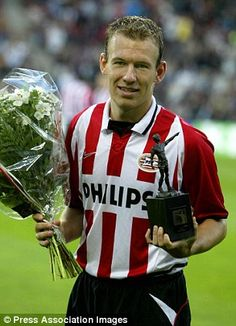 PSV Eindhoven's Arjen Robben with his 'Johan Cruyff Award' given to him for being the best young player in the Dutch Eredivisie