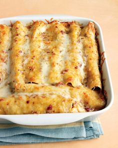 Lighter Chicken Enchiladas - Martha Stewart Recipes, most popular Martha recipe!Lighter Chicken Enchiladas - Martha Stewart Recipes, most popular Martha recipe! I Love Food, Good Food, Yummy Food, Fun Food, Martha Stewart Recipes, Enchilada Recipes, Enchilada Sauce, Enchilada Casserole, Chicken Casserole