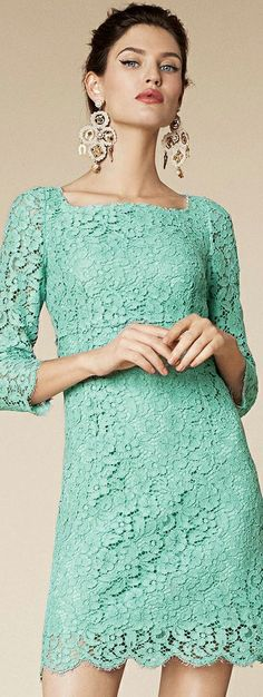 Mint green lace Dolce & Gabbana dress with gold chandelier earrings