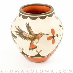 Handmade bowl from Zia Pueblo potter Elizabeth & Marcellus Medina with hand-painted hummingbird and nature designs.