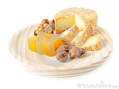Soft washed-rind cheese, hazelnuts, walnut and marmalade on the textured wooden board isolated on white
