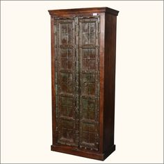 """Make your home the castle of your dreams with plenty of storage space with our Gothic Gates Wardrobe. This solid hardwood free standing closet will instantly expand your storage and help you keep things neat and organized. The handmade armoire stands 76.5"""" tall and has four wide shelves. The traditional cabinet stands directly on the ground and has double doors, each decorated with iron strips and rivets.  Wardrobes allow you to reclaim rooms with style. This rustic armoire is built with…"""