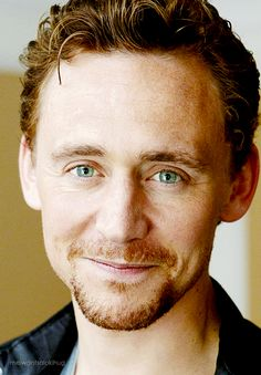 Tom Hiddleston. I absolutely love his smile... It's so infectious; how can you not smile when you see this?? XD