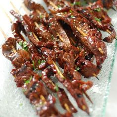 Beef Teriyaki ~ 1 flank steak cut into strips, on 16 bamboo skewers. Brush with 2 tsp sesame oil, salt & pepper, then grill. Teriyaki Glaze: 1 cup soy sauce, 1/2 cup brown sugar, 2 Tbsp honey, 1 Tbsp mirin, 1 Tbsp minced garlic, 1 tsp minced ginger, 1 Tbsp cornstarch, 1/4 cup cold water. Simmer glaze for about 10 minutes. Brush meat several times during grilling.
