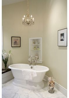 tub.  traditional bathroom by Mahoney Architects and Interiors