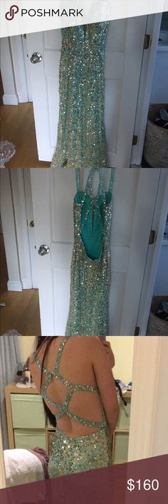 Prom dress Size 6 Val Stefani cut out fluted sheath prom dress. Features a sleeveless silhouette with flat tank straps, a cut out back with crisscrossing straps. A plunging neckline, but it is accented with sheer illusion netting gold and mint color. This dress has been taken in two inches under the bust and has 3 inches taken off the bottom but still hangs on the floor. Dresses Prom