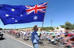 Cycling- AN AMERICAN FAN WITH AN AUSTRALIAN FLAG ON STAGE ONE OF THE TOUR DOWN UNDER
