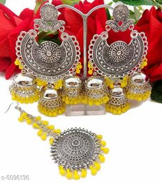 Jewellery Set Arya Stylish Women's Earrings and Maang Tikka  Base Metal: Alloy Plating: Silver Plated Stone Type: Artificial Stones Sizing: Non-Adjustable Type: 1 Pair of Jhumkas and Maang Tikka  Multipack: 1 Sizes Available: Free Size   Catalog Rating: ★4 (553)  Catalog Name: Arya Stylish Women's Earrings and Maang Tikka CatalogID_751135 C77-SC1093 Code: 581-5096136-