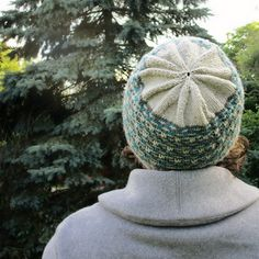 This hat is knit in the round on size 4 needles using three colors of Knit Picks Capretta. 190 yds. for the main color, and 65 yds. each of the two secondary colors.