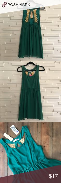 NWT Green and Gold Dress / Cocktail / Holiday This is the perfect dress for a holiday party! It is from a local boutique and the brand is Alma Mater for school colored clothing. I purchased it to wear to a Christmas party but went with something else. It has a pretty open back and very vibrant coloring. Would be cute if your school colors were green and gold or any other occasion really. Size small, new with tags! I can ship ASAP! Dresses