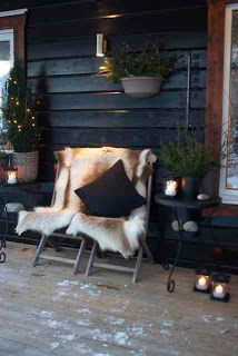 Cozy christmas porch with  throw, candles.