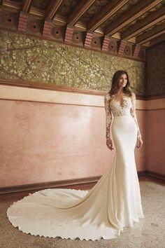 c3b72db52e9 Long sleeve illusion lace bodice sheath wedding dress with crepe skirt.