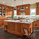 This kitchen features a hutch that provides two kinds of storage: on the top, wedding china on display; hidden in the bottom, the mismatched plastic lids every kitchen secretly contains.Congnac leather inserts are used at the island cabinet doors in place of the standard wood to add a sense of timelessness.