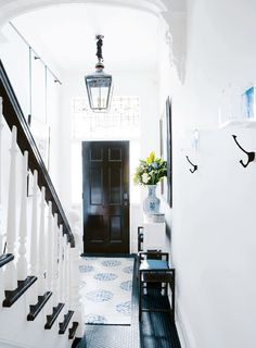 victorian meets modern.  black hexagon tile, lantern pendant, and architectural details.