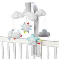 Oh, what a little moonlight can do! Skip Hop Baby Mobile has a soft color palette and sleek look to coordinate with the modern nursery. While stars are projected on the ceiling, it lulls little one to sleep with gently glowing clouds along with eight total lullabies and nature sounds. Just use the light and sound combination that's right for your baby. A remote control allows you to restart the mobile after 20 minutes with the touch of a button, even from outside the nursery. Music to Sk...