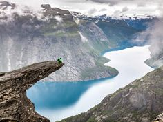 "Trolltunga, which aptly translates to ""Troll's Tongue,"" is one of many examples of Norway's bizarrely beautiful landscape. The protruding rock sits about 2,300 feet above Lake Ringedalsvatnet, daring travelers to sit on the edge and pose for what is sure to be a profile picture a lifetime."