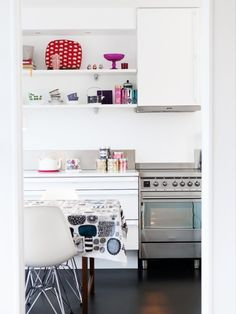 white kitchen with open shelves and colourful accessories