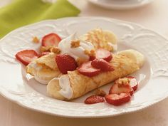 Strawberry-Banana Crepes. For Crepes,1 cup original Bisquick mix, 3/4 cup milk, 2 eggs. For filling, 1 1/2 cups whipping cream, 1/4 cup sugar, 2 to 3 bananas(sliced), 1 pint (2 cups) fresh strawberries(sliced) or 1 box (10 oz) frozen strawberries( partially thawed), 1/4 cup chopped walnuts.