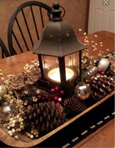 60 Most Popular Christmas Table Decoration Ideas. Decorating your table for Christmas can be as simple or as elaborate as you want to make it. But, there is one primary secret to Christmas table decor. Diy Christmas Decorations, Christmas Table Centerpieces, Lantern Centerpieces, Centerpiece Ideas, Coffee Table Christmas Decor, Christmas Coffee, Christmas Lanterns, Christmas Decorating Ideas, Christmas Island