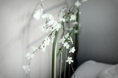 Cabecero de hierro con flores