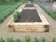 Oak railway sleepers used to create raised vegetable beds. Small City Garden, Small Garden Design, Raised Garden Beds, Raised Beds, Back Gardens, Outdoor Gardens, Railway Sleepers Garden, North Facing Garden, Garden Planning