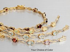 5.00ctw Oval Blue Topaz With Oval Diamond Accent, Sterling Silver And 18k Yellow Gold Over Sterling Silver Bracelet