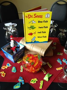 How cute is this Dr. Seuss themed table? A mini Cat in the Hat, a bowl of Sweedish fish, and a stack of Dr. Seuss books and you have another guest table.