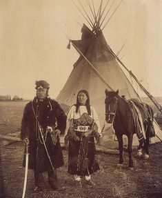 Dog Child, a North West Mounted Police scout, and his wife, The Only Handsome Woman, members of the Blackfoot Nation, Gleichen, Alberta, ca. 1890