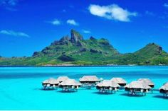 Four Seasons Resort Bora Bora! We really want to go here! I just wish it didn't take FOREVER and a day on a plane to get there. One of these years I'll suck up the plane ride and we will vacation here!