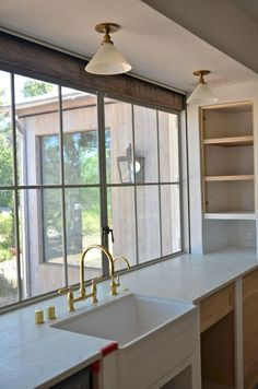 Windows at counter-top level, rustic wood detail, semi-flush mounts