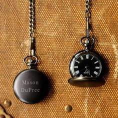 For your groom or groomsmen, give them this handsome personalized midnight pocket watch.