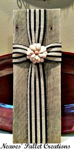 "RECYCLED WOOD PALLETS: Here is another Sweet Rustic Burlap Cross. These are larger than the ones we previously made. These are 16""-16.5"" tall and 6"" wide. They are both embellished with paper rosettes and the teal Cross has a sprig of pearled beads. We are selling these for $12 each. Message us if interested in purchasing one of these Crosses. Share our post with friends if you think they would like them too.  Item #819"