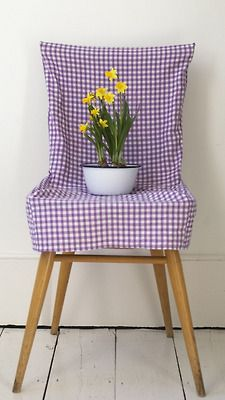 Slipcover that modern chair in gingham and see what happens?