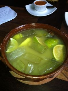 Great local drink in Guadalajara - tequila with orange and limes on ice in a round bowl