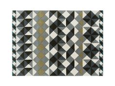 The GAN MosaïekRug is part of the GAN Hand Tufted Collection and features a unique and modern design.