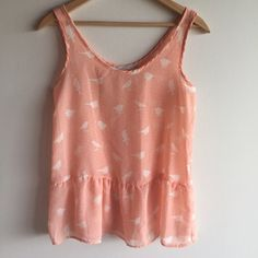 """Host Pick! Bird print peplum top Adorable peach colored peplum sleeveless top with white birds and very pale green polka dots. Sheer 100% polyester. Measures  25"""" long and 16"""" across bust. Too small on me up top. Great condition! Rolla Coster Tops"""