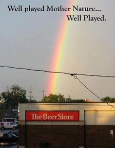 rainbow ends at roof of Beer Store ,well played Mother Nature, Well Played Indeed the pot of gold at end of rainbow May 2013,
