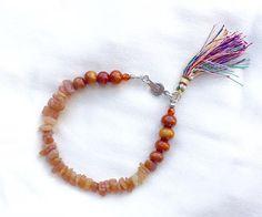 Go ahead and give this a look 🙂 Orange Tassel Bracelet with Aventurine Chips, Layering Bracelets, Peach Aventurine, Wooden Bracelet https://www.etsy.com/listing/456241698/orange-tassel-bracelet-with-aventurine?utm_campaign=crowdfire&utm_content=crowdfire&utm_medium=social&utm_source=pinterest