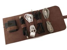 Leather cable holder cable organizer cord wrap travel case etsy within leather cord organizer decorating Iphone Ladegerät, Iphone Charger, Leather Cord, Leather Craft, Donut Friend, Accessoires Photo, Cord Organization, Cable Organizer, Bath And Beyond Coupon