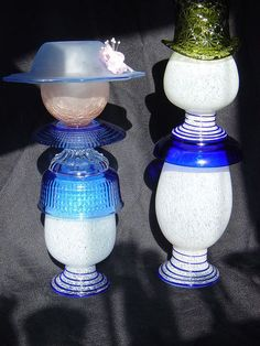 repurposed glass, repurposing upcycling, The Mrs out for a stroll with her man When I found the three matching vases I knew they needed to stay together Assembled by Nita Hooper Garden Whimsy, Diy Garden, Garden Projects, Garden Ideas, Garden Crafts, Backyard Ideas, Upcycled Garden, Art Projects, Vase Centerpieces