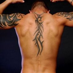 yanno... for some reason im not even paying attention to the tattoo... just them back muscles...
