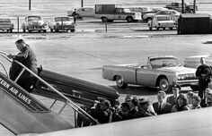 Around 2:15 p.m., President John F. Kennedy's casket is placed aboard Air Force One. Four seats and a partition had to be removed from the presidential plane to make room for the casket.