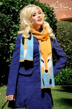 Quirky Fox Head and Tail Knit Scarf - Flock to this fox(y) scarf!  Scarves are rarely as adorable as this one, or as comfortable with its touch of angora and long length perfect for warming wrapping around your neck or hanging loosely for some quirky accessorizing.  Thick and wonderfully soft, this intarsia-knit scarf will make you appreciate cold weather more than you ever expected.  Please consider adopting this warm and cuddly scarf... it will love you just as much as you love it!