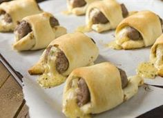 Cheesy Crescent Bratdogs Recipe- think I will have to try them with brats, sauerkraut & swiss cheese though.