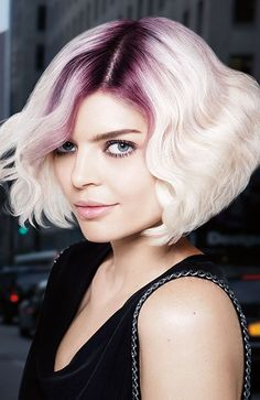 If you're looking to have some fun, and you're already platinum blonde, amethyst roots are something to consider. Besides, we all know how tough that root grow-out can be, even if it is trendy right now. Incorporating some color at the root extends time between touch ups — which is ultimately much healthier for your hair.