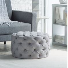 Allover Grey Round Tufted Ottoman
